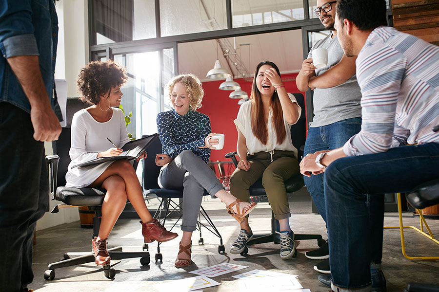 Employee Benefits - Cheerful Employees Sitting In Office During Meeting
